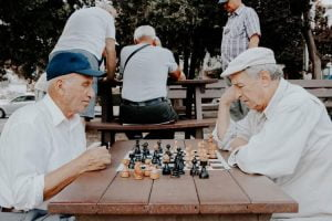 Aged people enjoying a game of chess