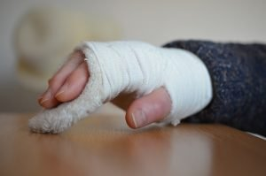 Person's hand wrapped in bandages